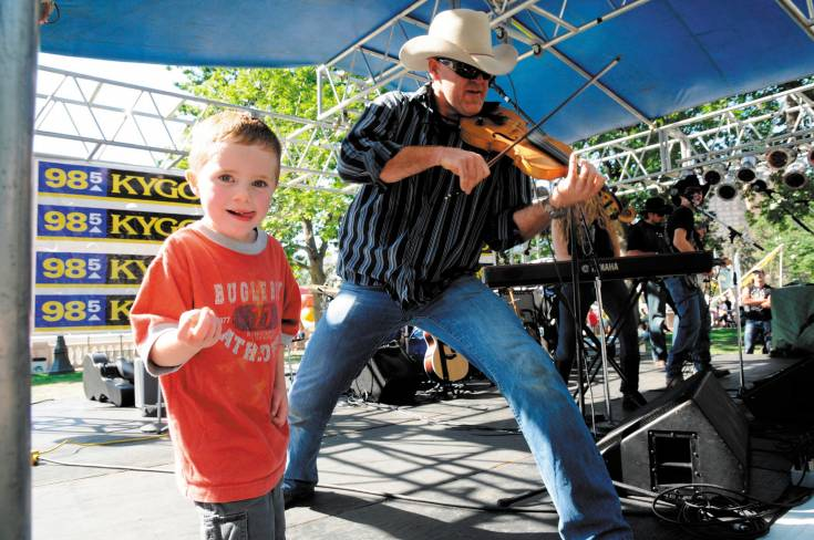Kids are especially welcome at the Taste of Colorado, where they can dance to a bit of country music.