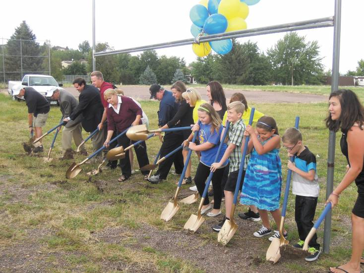 Foothills Elementary staff, community members and supporters break ground on the Field of Dreams project.