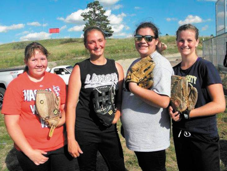 Happy to lead the way for this year's Elizabeth softball season are, from left, Maegen Jaecer, Jessi Dodge, Kimmy Handley and Adison Bernier.