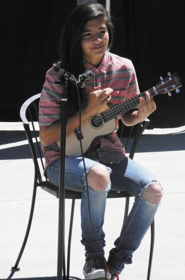 Haley Villareal plays the ukulele during the Elizabeth Music and Art Festival on Aug. 23. Courtesy photo