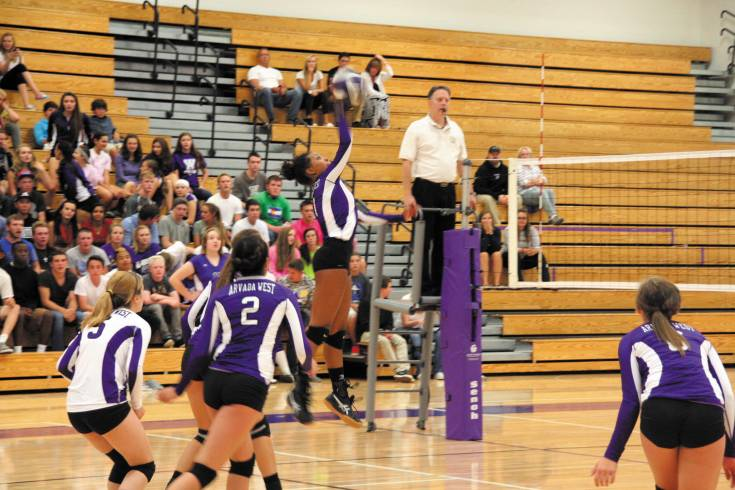 Arvada West junior Mikaila Paxton goes airborne and spikes what was a kill shot during the Wildcats match with Broomfield Thursday at A-West High School. But Broomfield won the match 3-2.