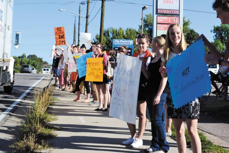 Lakewood students lined Kipling Street with placards expressing concerns about planned Jeffco board review of the AP U.S. History course in Jeffco high schools.