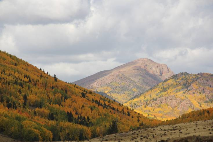 Rock-topped Aspen range in color and elevation between Victor and Gillette Flats. Below, Color seems to blow the roof off a cow shed in Beaver Valley.