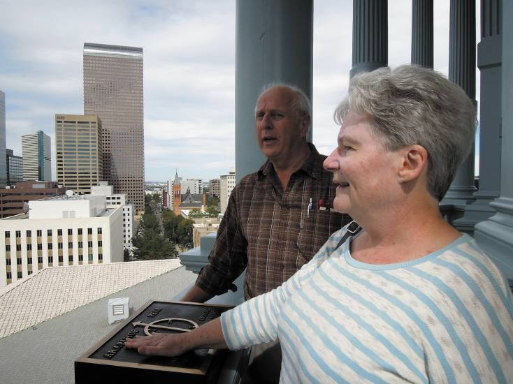 Rick and Erma Kircheis of Belmont, Michigan look out on the city of Denver from the newly re-opened Capitol observation deck on Oct. 2. Photo by Vic Vela