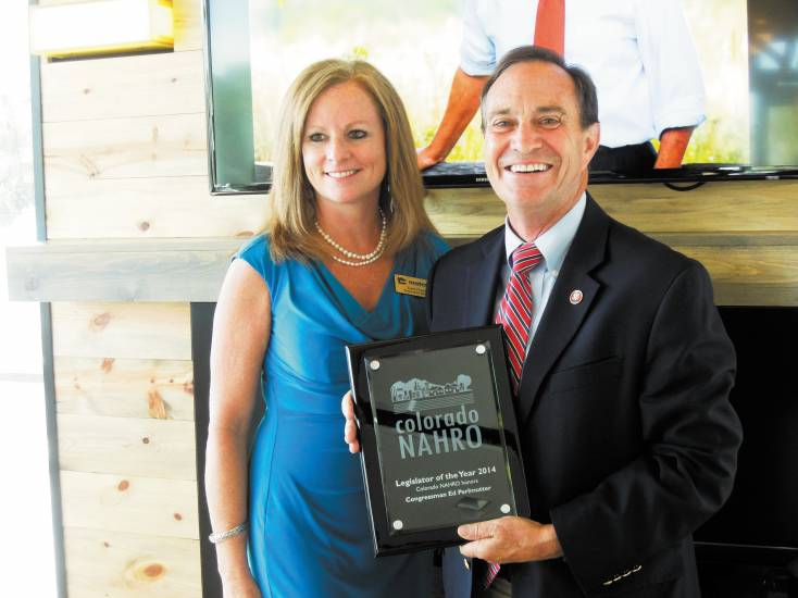 "Rep. Ed Perlmutter visited Lamar Station Crossing on Oct. 6 to receive the Colorado chapter of National Association of Housing and Redevelopment Officials' (NAHRO) ""Legislator of the Year"" award from Tami Fischer, executive director and CEO of Metro West Housing Solutions."