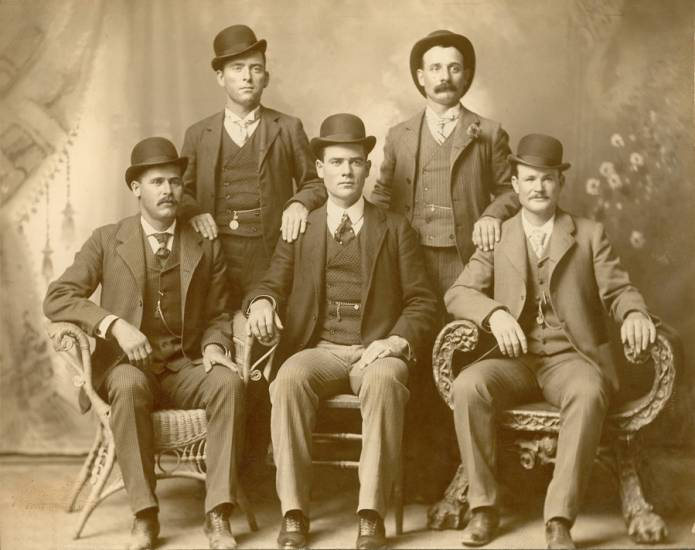 "The Wild Bunch, From left to right: Harry A. Longabaugh, a.k.a. ""The Sundance Kid,"" William Carver, Ben Kilpatrick, a.k.a. ""The Tall Texan,"" Harvey Logan, a.k.a. ""Kid Curry"" and Robert Leroy Parker, a.k.a. ""Butch Cassidy."" The photo was taken Nov. 21, 1900, at John Swartz's studio in Fort Worth, Texas."