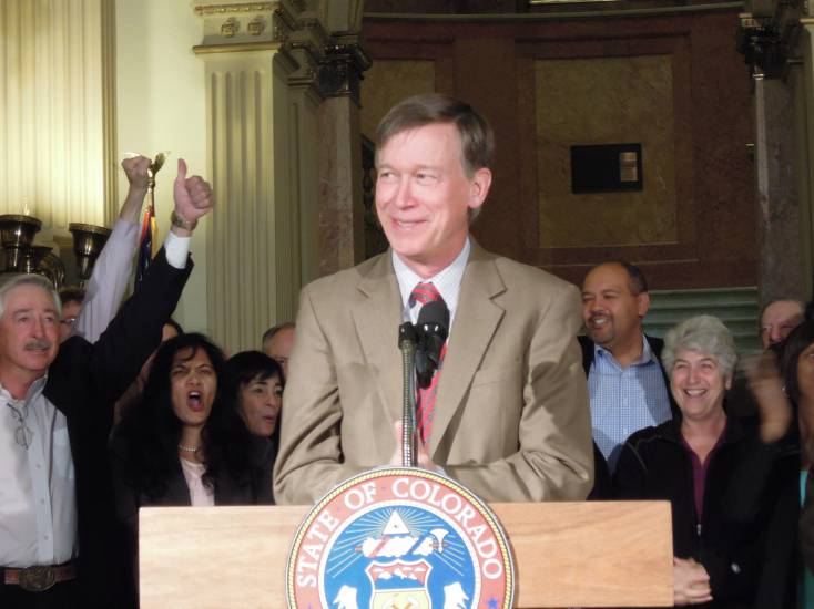 Supporters cheer as Gov. John Hickenlooper gives a re-election victory speech inside the Capitol on Nov. 5. Photo by Vic Vela