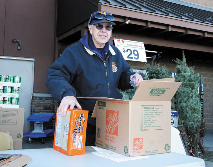 John Leybourne, director of this year's food drive, packs boxes.