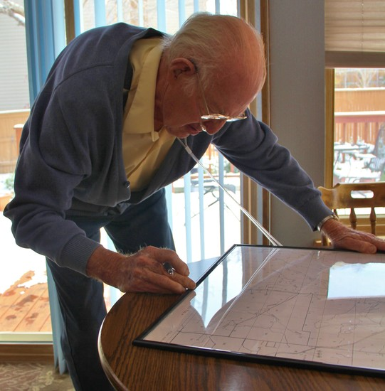 Franklin Harn, 92, looks over a map of Parker in the 1930s that he drew by hand.