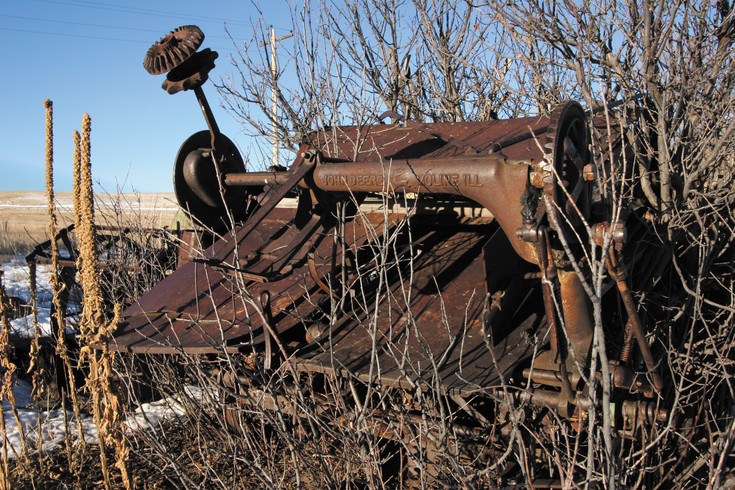 Old farm equipment surrounds the original homestead.