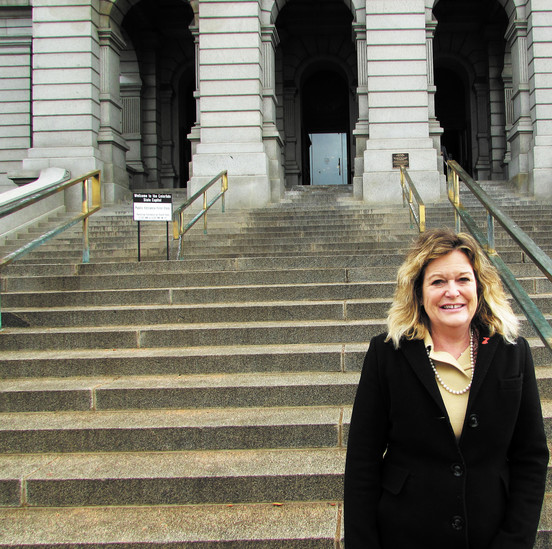 Colorado State Rep. Tracy Kraft-Tharp stands on the capital's front steps after being sworn in for the 2015 Legislative Session.