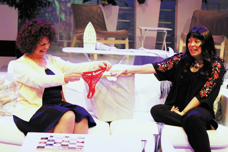 "LuAnn Buckstein as Virginia, left, expresses her surprise at finding a pair of skimpy woman's panties in the wash to Viviane Rinaldei as Matilda during a performance of ""The Clean House."" The play ""The Clean House"" is the current production on stage at the Town Hall Arts Center."