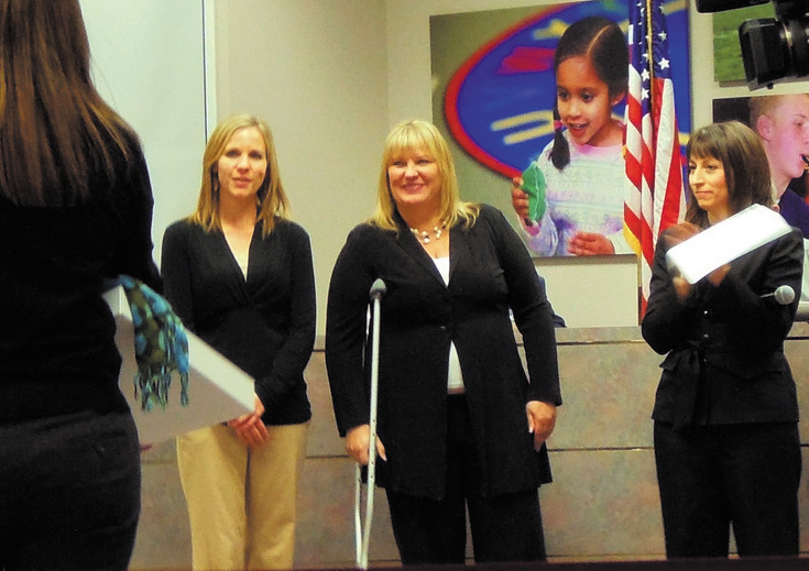 From left, Redstone Elementary staff member Jill Casas, principal Laura Wilson, and DCSD superintendent Elizabeth Fagen react during the Jan. 20 board meeting as Apple staffers talk about Redstone's Apple Distinguished School award. Photo by Jane Reuter