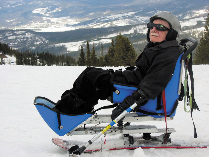 Dr. Severance Kelley, an 81-year-old retired psychiatrist and war veteran with post-polio syndrome, went skiing again last April for the first time in 22 years. Pictured is Kelley on a Mountain Man bi-ski at the National Sports Center for the Disabled in Winter Park.
