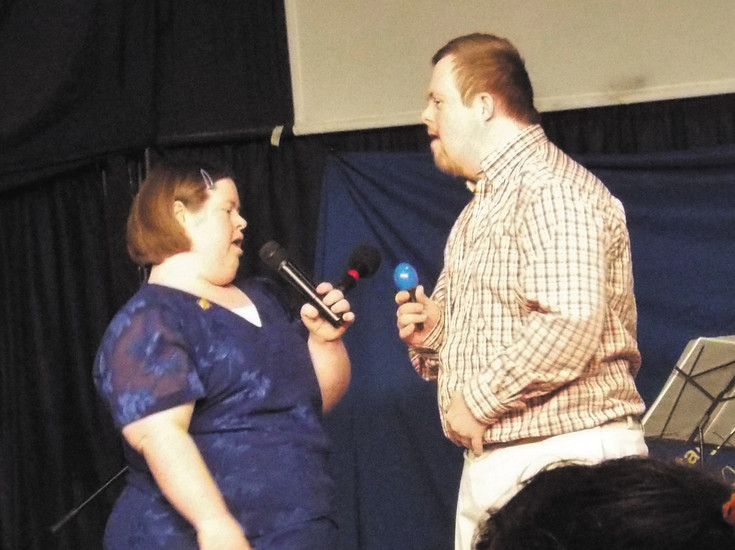 "Rotary Community Corps members Elizabeth Perkins and Paul Triggs sing ""Let It​ Go"" from the Disney hit movie ""Frozen"" during the club's fifth anniversary celebration. The club involves 45 special needs adults and teens in community projects. Courtesy photo"
