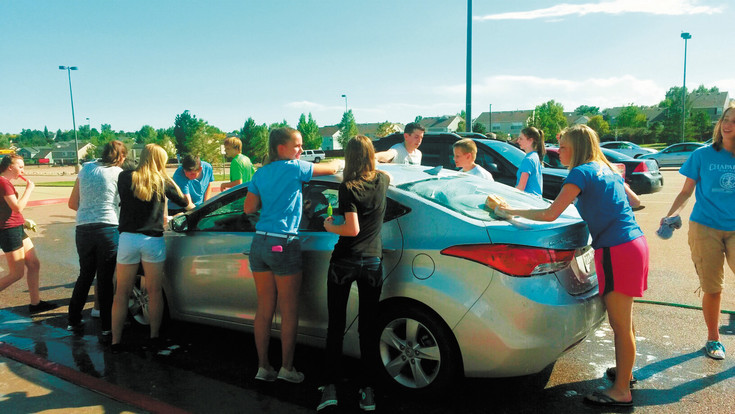 Members of Chaparral High School's Interact Club wash a teacher's car as part of Kellyn Dassler's September 2014 Girl Scout Gold Award project. Courtesy photo