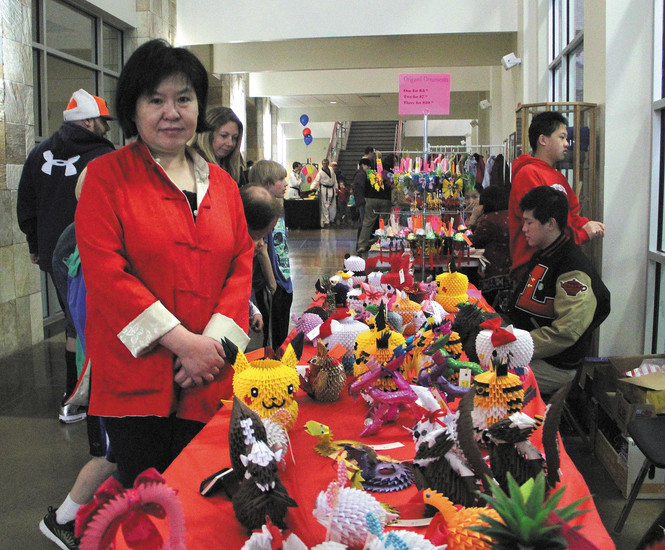 Jessie Lo stands with her table of origami art during the Chinese New Year celebration at Southridge Recreation Center Feb. 21. To see more of Lo's origami, visit www.jessielo.com and select 'table of contents.' Photo by Christy Steadman
