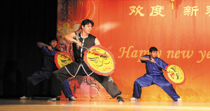 Three students of the National Martial Arts Academy give a kung fu demonstration at the Chinese New Year celebration Feb. 21 at the Southridge Recreation Center in Highlands Ranch.