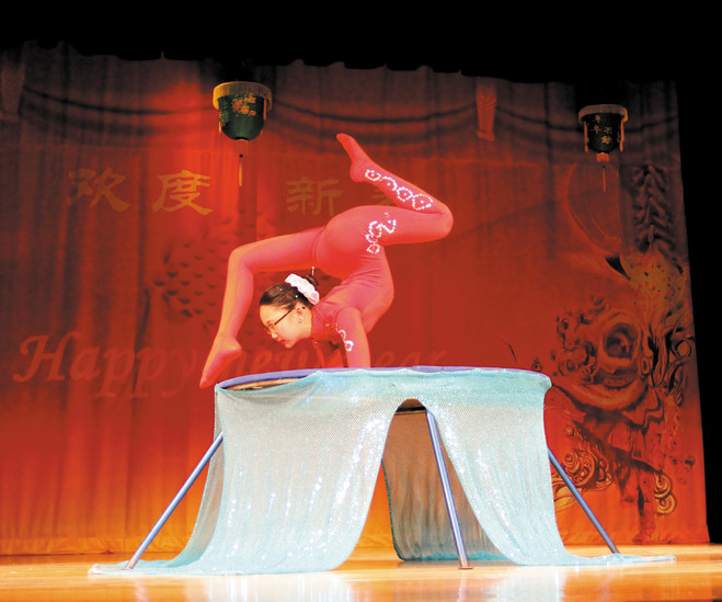 Sandy Battulga give a contortion demonstration at the Feb. 21 Chinese New Year celebration. Contortion is a Chinese art form of bending the body. Photo by Christy Steadman