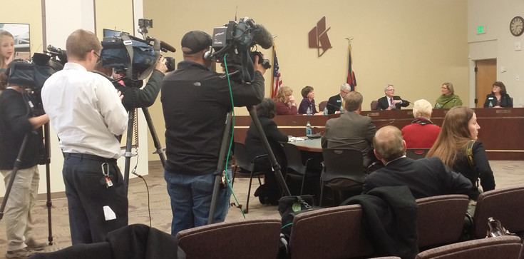The Littleton Public Schools Board of Education prepares to vote on the Davis family proposal. Photo by Jennifer Smith