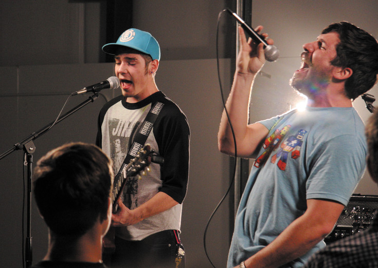 Lead singer John Sullivan and brother Paul Sullivan, on base, of the band Sibling Rivalry perform at the Elbert County Fairgrounds in Kiowa on April 4 in the second High Plains Battle of the Bands.