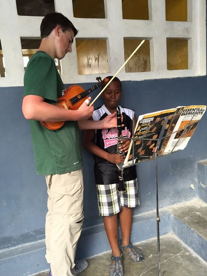 Zach Harris delivers music lesson to local student