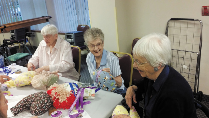 (From left) Fran Wills, Irene Schuster and Joan Zilis enjoy the camaraderie  this volunteer project affords them.