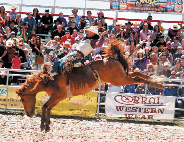 Seth Hardwick competes in the bareback competition at the Elizabeth Stampede Rodeo on June 6.