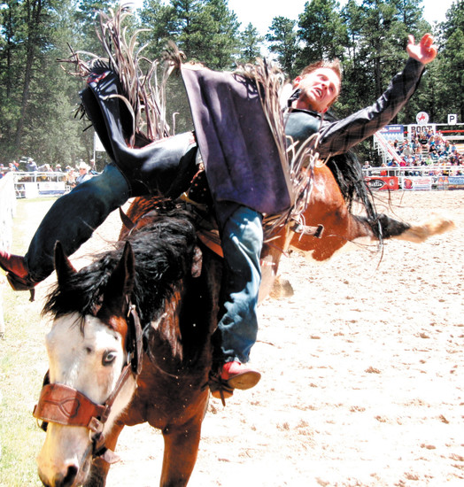 Tyler Scales competes in the bareback competition at the Elizabeth Stampede Rodeo on June 6.