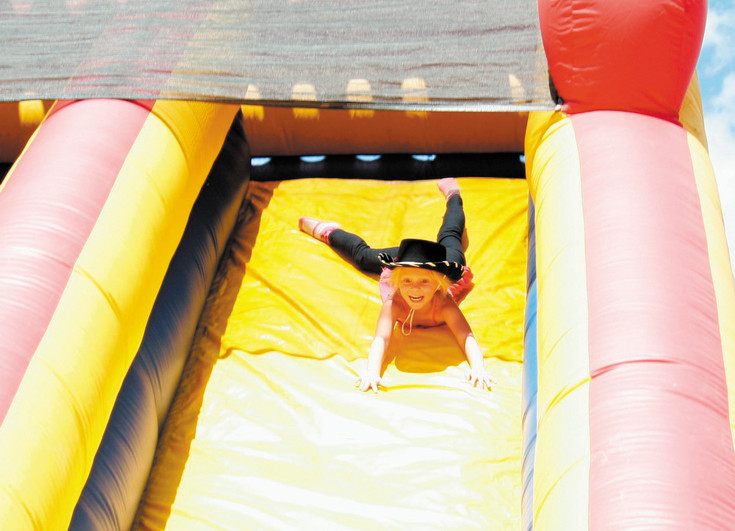 Zienna Shade heads down an inflatable slide at ElizaBash on June 6.
