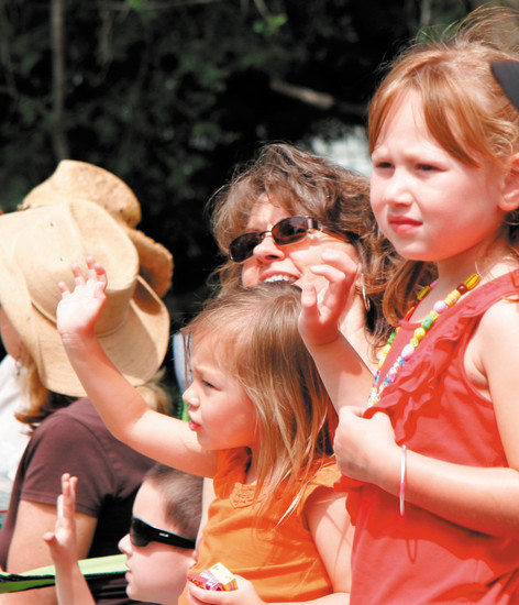 Pixie Paul and granddaughters Bailey and Kylie Paul watch the Elizabeth Stampede Parade the morning of June 6.