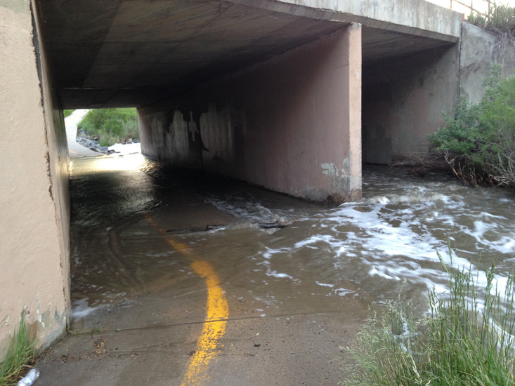 The pedestrian tunnel on the Willow Creek Trail that passes underneath Quebec Street in Centennial floods after a heavy June rainstorm. Photo by Jane Reuter