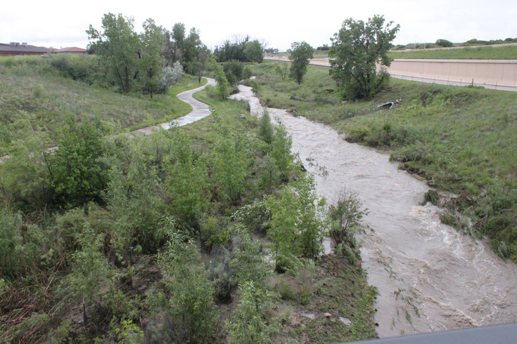 The waters of Plum Creek in Castle Rock were running high the morning of June 12. Flash flood warnings were issued for Douglas County earlier in the morning. Photo by Mike DiFerdinando