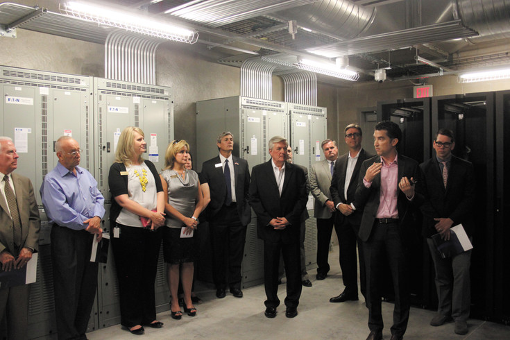 Douglas County Commissioners Jill Repella, David Weaver and Roger Partridge tour the new OneNeck Data Center in Englewood June 23.