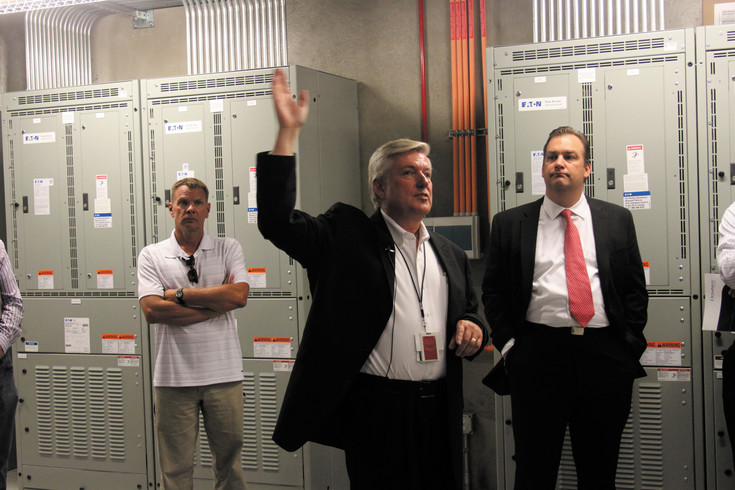 Hank Koch, Vice President of Mission Critical Data Center Facilities for OneNeck shows off the sever room at the new location at 8675 Concord Center Drive in Englewood.