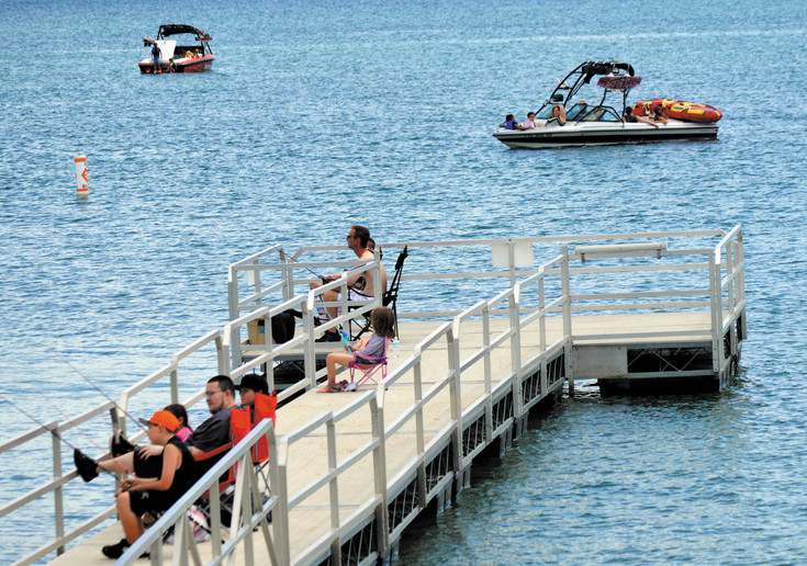 Families enjoy a relaxing Friday afternoon at Standley Lake Regional Park in Westminster.