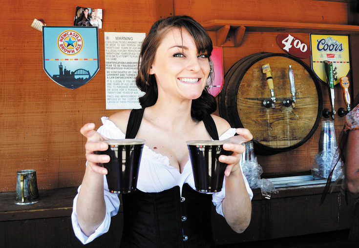 Colorado Renaissance Festival bartender Janay Cathy of Larkspur hands out some brews.
