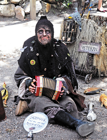 'Skidmark' provided some accordian entertainment for crowds passing by at the Colorado Renaissance Festival in Larkspur.