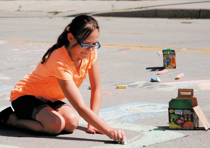 Sydney Kissinger, of Kiowa, works on her drawing for the Chalk Art Contest.