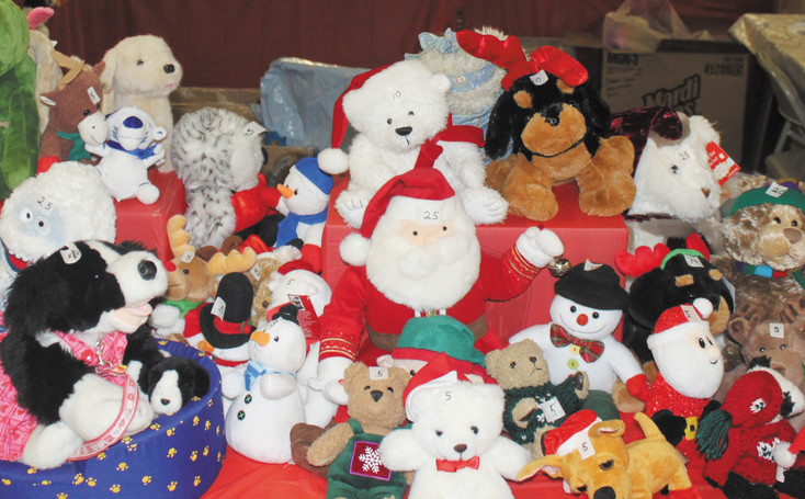 Among the thousands of toys given out each year by the Arapahoe Santa Claus Shop, stuffed toys are very popular with the younger children. Courtesy photo