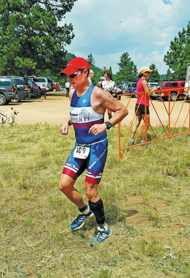 Craig Vogtsberger of Highlands Ranch, who was diagnosed with foot drop after a military training accident, competes in triatholons using an Allard BlueRocker. The Rocker on his left leg has allowed him to qualify for the XTERRA USA Championship in Odgen, Utah, on Sept. 19. Courtesy photo