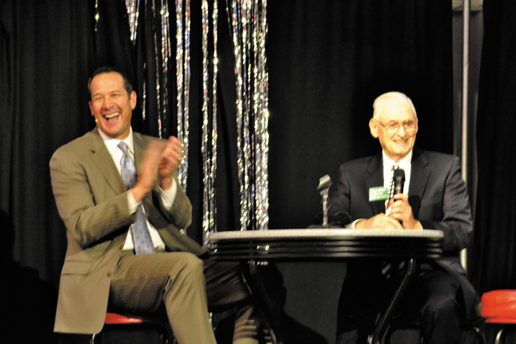 During the Arvada Chamber of Commerce City Council Forum, council member Mark McGoff, left, makes a joke about the recent last-minute Denver Broncos win over the Kansas City Chiefs to moderator, Jim Siedlecki.