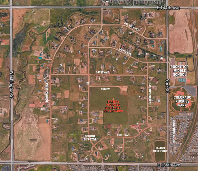 A photo showing the proposed new well sites, east of Interstate 25 and north of East 136th Avenue. Residential houses ring the well site, which is already the site of some oil wells.