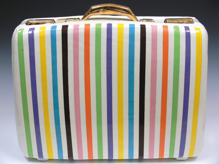 The ceramic suitcases by David Bogus show the potential for creativity and reality that slip cast ceramics fosters.