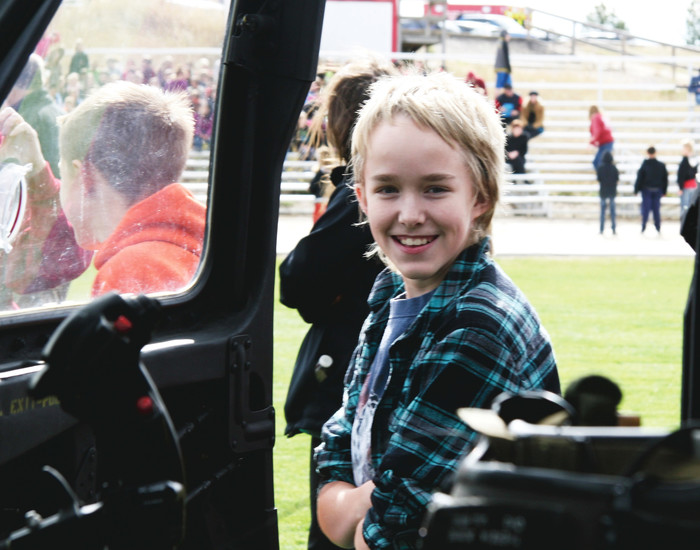 Logan McMullen checks out cockpit of Colorado Army National Guard UH-60 Helicopter.
