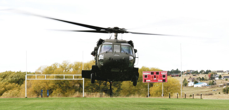 Colorado Army National Guard UH-60 Helicopter lands at Elizabeth Middle School athletic field.