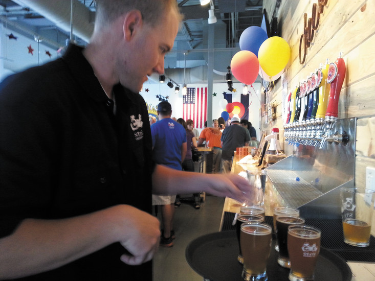 Manager Lael Callaway serves up 38 State's custom brews. File photo
