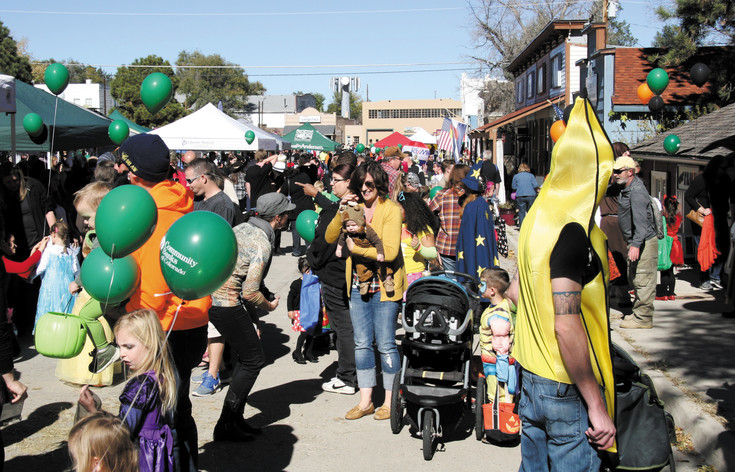 Crowds pack Historic Main Street in Elizabeth for Harvest Fest and trick-or treating.