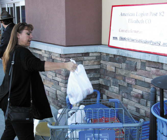 Vicki Miller of Parker drops off a bag of food following her shopping trip to Walmart.