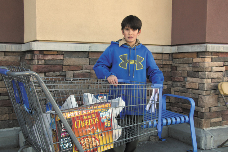 Boy Scout Keeler Sparks, a seventh grader at Kiowa Middle School volunteers for the American Legion Post 82 Christmas Food Basket Drive on his day off from school.